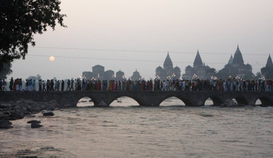 A religious procession crossing the bridge over River Betwa